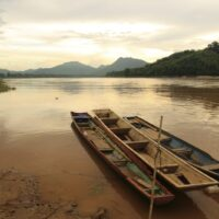 Traditional boat in sunset time at Mekong River, near Kratie, Cambodia
