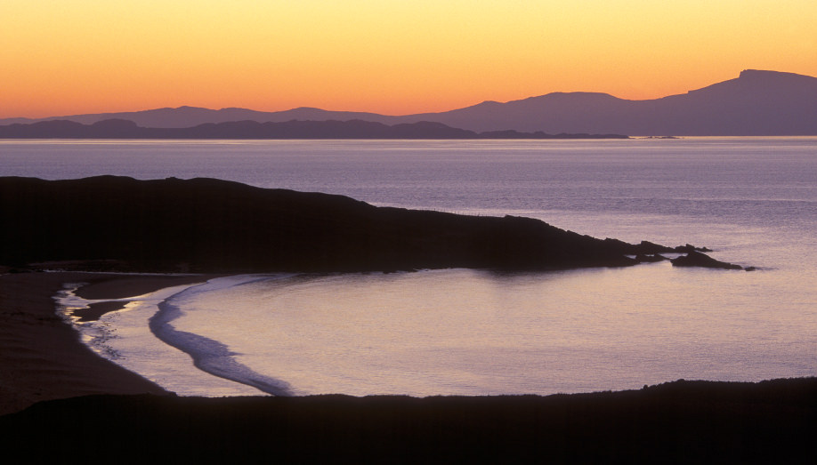 A view of the Isle of Rona's distant neighboring Isles. They are but silhouettes in the sunset.