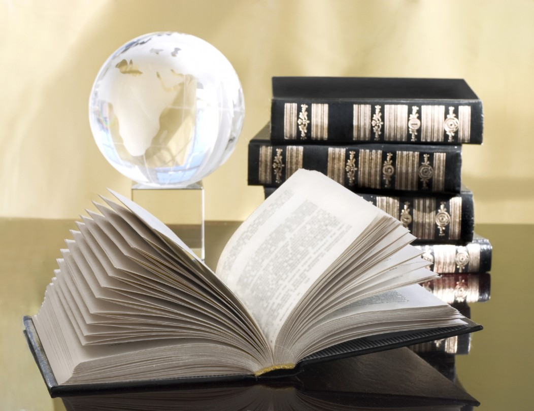 Travel Archives: picture of books and a crystal world globe.