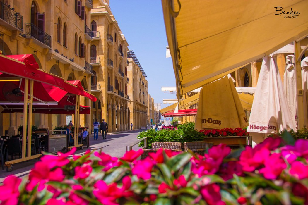 A beautiful avenue of downtown Beirut, Lebanon. Flowers i the foreground and a cafe and long street in the background.