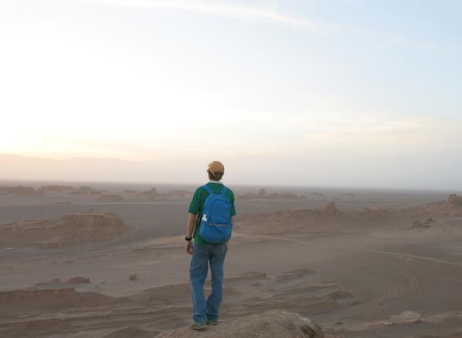 Jonny Blair backpacking in Kaluts desert Iran