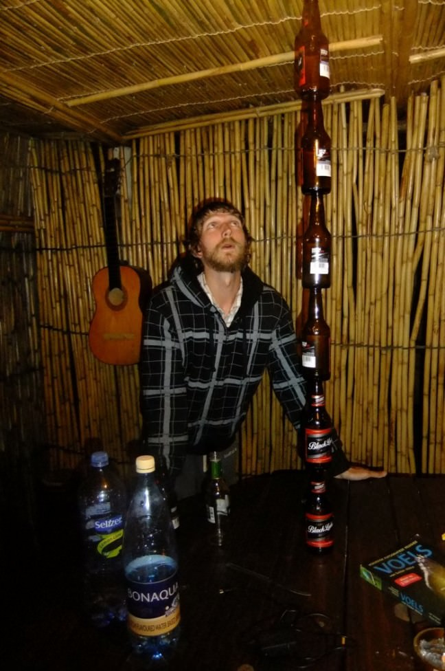 Jonny Blair balancing beer bottles in Soweto South Africa