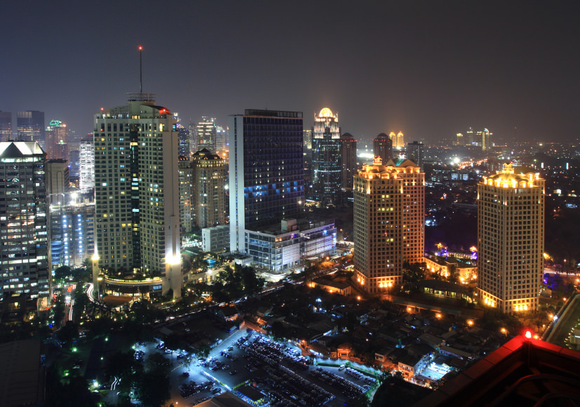 A panoramic view of the Jakarta, Indonesia skyline at night.