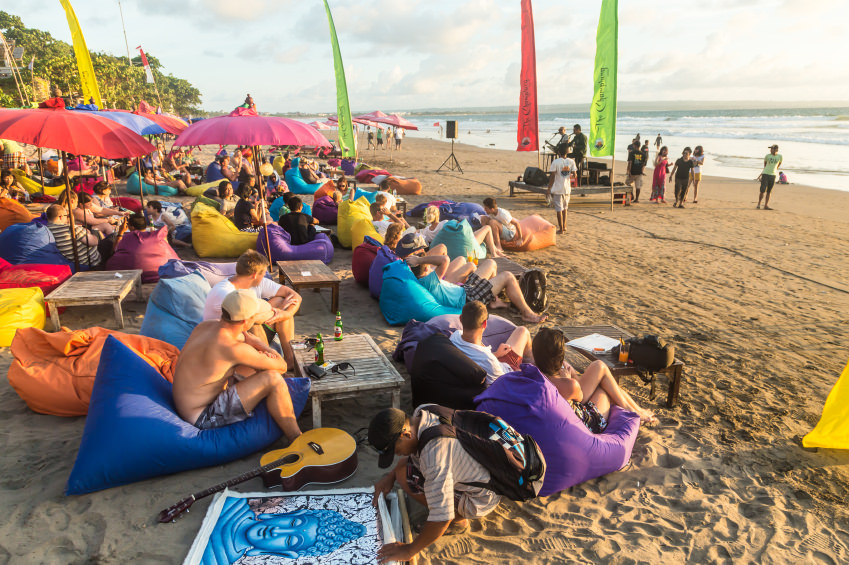 A crowd of expats enjoying drinks on a Seminyak beach bar in Bali, Indonesia