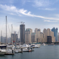 The numerous highrises pictured hint at the high cost of living in Dubai. The Dubai, UAE, marina in the foreground