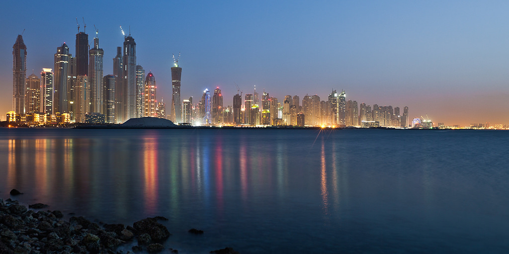 "A picture of the Dubai skyline at night, with the sea in the foreground. Lead picture on ""How to find a job in Dubai""."