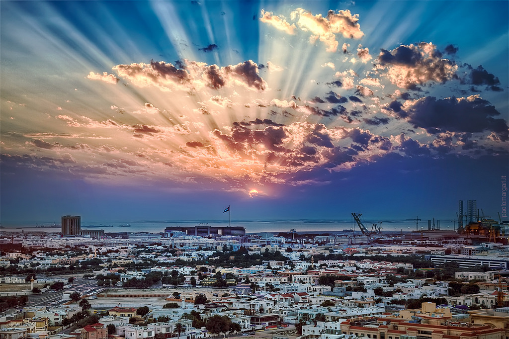 A sunrise over the bay and beaxh in Dubai, United Arab Emirates.