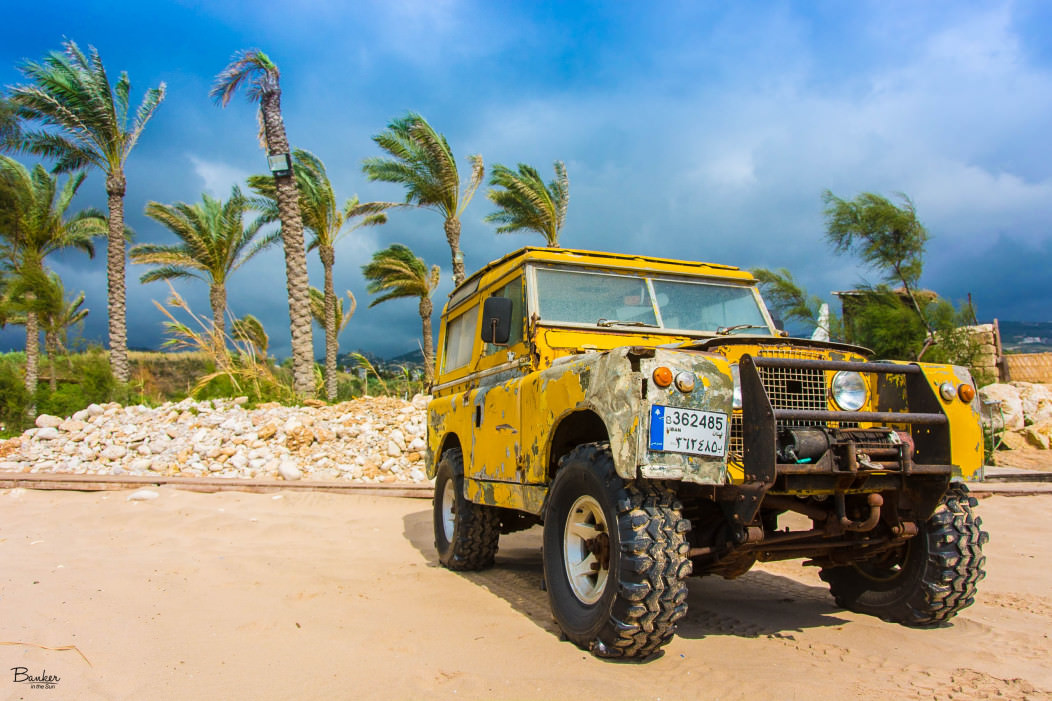 A Jeep car on a beautiful Mediterranean beach in France.