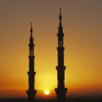 Silhouette of minarets of Nabawi mosqued during a sunset in Medina, Saudi Arabia. One beautiful reason to prepare for life in Saudi Arabia.