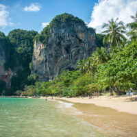 Ao Tonsai on Railay Beach in Krabi Province, Thailand. A small, isolated beach, cupped against a shore with lush mountains close behind.