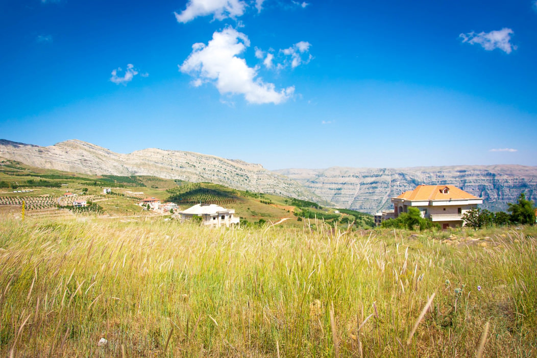 A panoramic picture of houses in a vast valley on the Syrian Lebanese border.