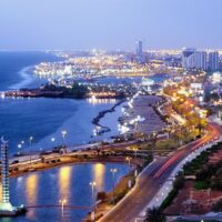 Beautiful evening picture of the beach and city of Jeddah, Saudi Arabia. Expats living in Jeddah's corniche area will enjoy this coastal setting.