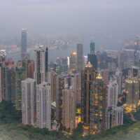 A panoramic picture of Hong Kong and Kowloon as seen from Victoria Peak. Living in Hong Kong, as pictured here, would seem as crowded as New York.