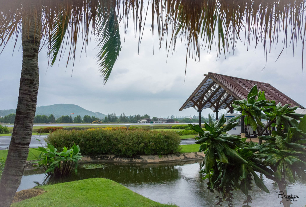 Koh Samui airport in Thailand on an overcast day. It looks very tropical and peaceful, yet small.