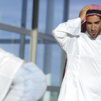 """A picture of the waist down of a Saudi man and non-Saudi woman. They are wearing traditional clothes and close together. Lead picture of """"Should non-Saudi women get involved with Saudi men."""""""