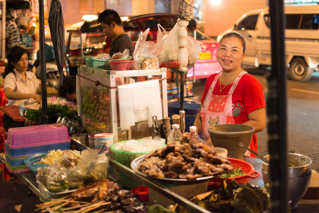 A typical street food vendor in Silom, Bangkok, selling pork stew at night. An every day sight in Bangkok life.