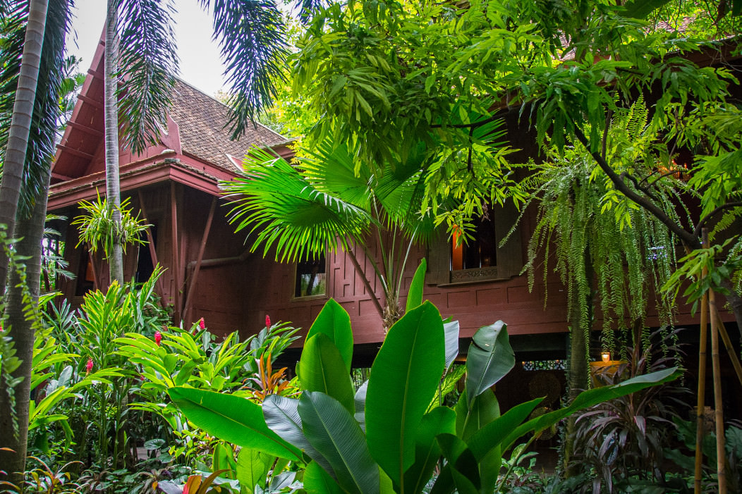 Jim Thompson's house in Bangkok, Thailand. It is set in a lush tropical garden, and is made of ancient Thai wood.