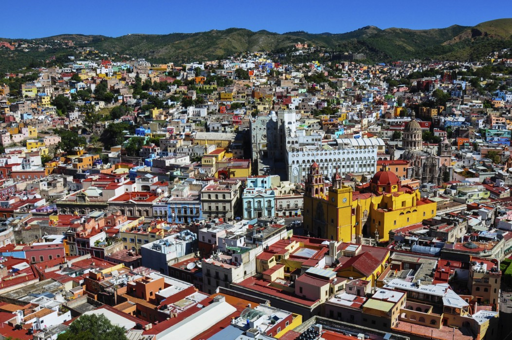 The panorama of the colonial city of Guanajuato in Mexico. It looks very modern and colorful. The mountain range can be seen in the background.