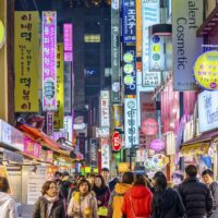 Electric neon of the Myeong-Dong Shopping District in South Korea at night. It is crowded with Koreans and tourists, and looks amazing. The technology clearly shows the cost of living in South Korea will be comparatively high.