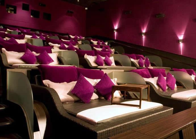The velvet room in Jakarta, Indonesia. A cinema full of king-sized beds with purple velvet pillows.