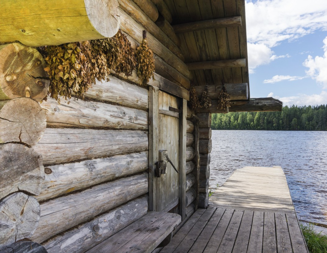 Russian bathhouse, called a Banya, on the Volga river. It is a log house with a river pier.
