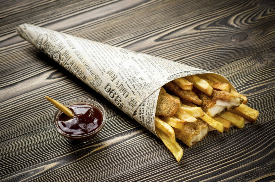 Fish and Chips wrapped in a newspaper. This popular and cheap British snack keeps your cost of living in the UK down.