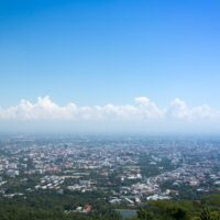 Beautiful skyline of Chiang Mai, Thailand. A line of clouds hangs over the city.
