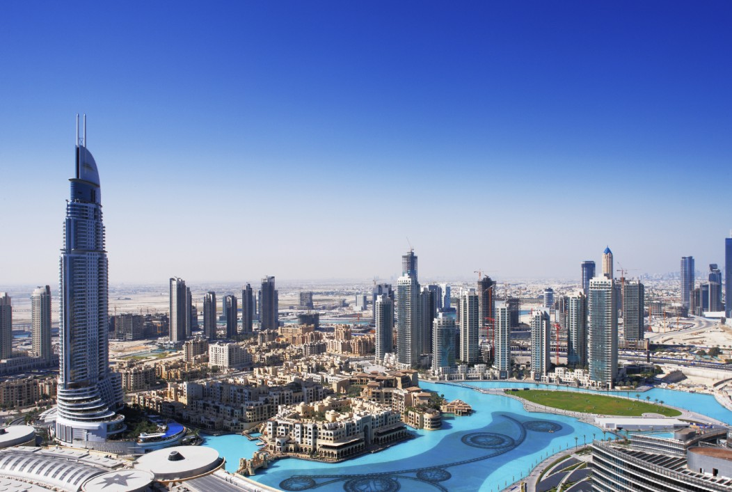 A beautiful panoramic skyline of Dubai during the day.