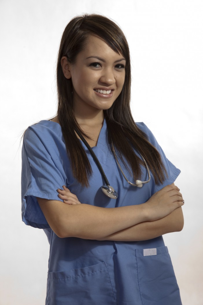 A filipino nurse posing for a photo. Filipino nurses represent one a growing segment of the healthcare sector in Saudi Arabia.