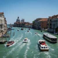 The canals and boats of Venice, one of the best last minute holiday destinations.