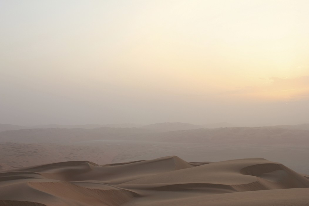 An Nafoud desert in Saudi Arabia. It looks beautiful and endless, with a fine haze in the air during sunset. Seeing it is one of the reasons you should move to Saudi Arabia.