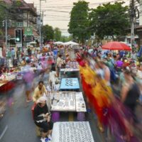 Bustling expat life in Chiang Mai's walking street. It is packed with tourists and expats alike shopping for goods.