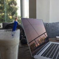 My laptop and smoothie in Cambodia as I write the article: Guide to Dropshipping.