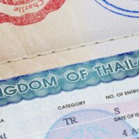 Thai tourist visa stamp in a passport.
