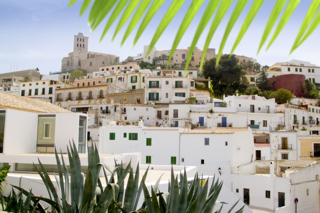 The dalt vila downtown area of Ibiza in Spain. The buildings are white and rustic.