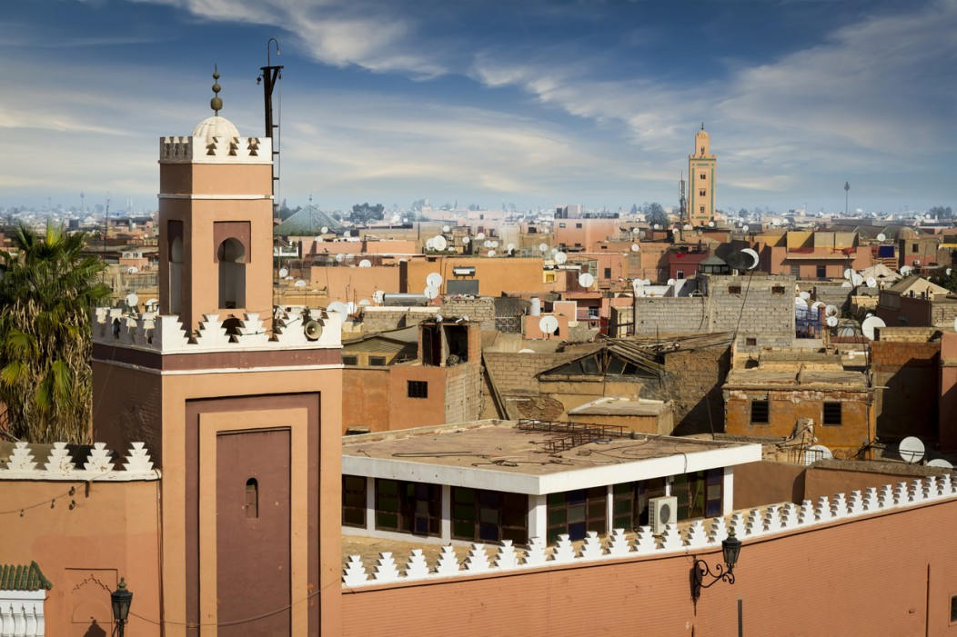 The medina of Marrakesh in Morocco is a beautiful pinkish-brown with exotic, old Moroccan architecture.