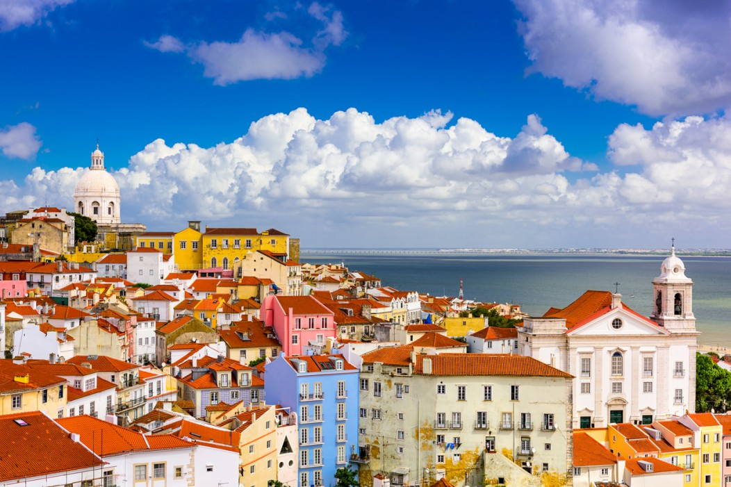 Seaside Lisbon in Portugal is one of the top destinations on a budget. The houses and buildings look colorful and the whole city is seaside.