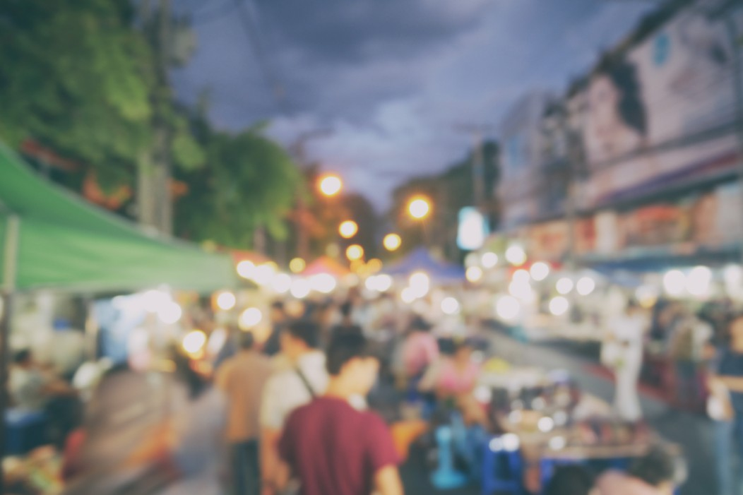 A defocused photo of Chiang Mai's night market.