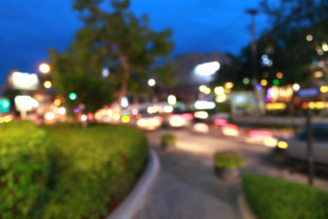 A defocused photo of Chiang Mai's colorful streets at dusk.
